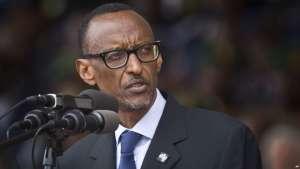 FILE - Rwandan President Paul Kagame addresses the public and dignitaries at a ceremony to mark the 20th anniversary of the Rwandan genocide, at Amahoro stadium in Kigali, Rwanda.