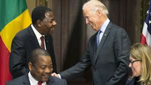 Vice President Joe Biden (right) shakes hands with Benin's President Thomas Boni Yayi, during a Compact Signing Ceremony in the Indian Treaty Room at the White House in Washington, Sept. 9, 2015.