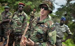 File picturesOn the trail: U.S. Army special forces Captain Gregory, from Texas (center) speaks with troops from the Central African Republic and Uganda, in Obo.Pic credit Daily Mail