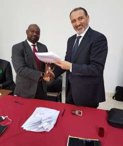 Osam Iyahen, Vice President of Investments and Natural Resources at AFC and Mohamed Toumi, CEO of Topic during the signing of the agreement.