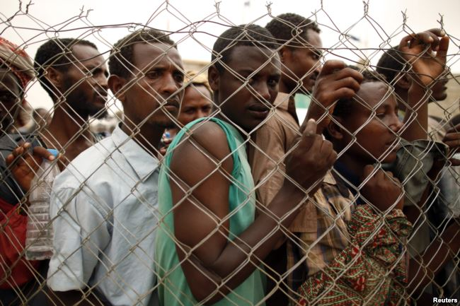 FILE - Ethiopia migrant workers seeking jobs in Saudi Arabia are turned back on March 16, 2012, in Haradh, a town in western Yemen.
