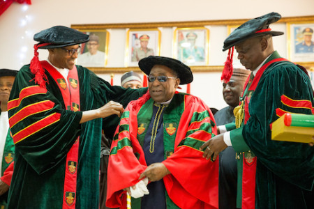 President Muhammadu Buhari assisted by Commandant Nigerian Defence Academy Maj. Gen. MT Ibrahim as the President conferred upon Malam Yusuf Maitama Sule Honorary Doctor of Letters during the NDA convocation in Kaduna on 12th Sept 2015.Pic Credit News Nigeria