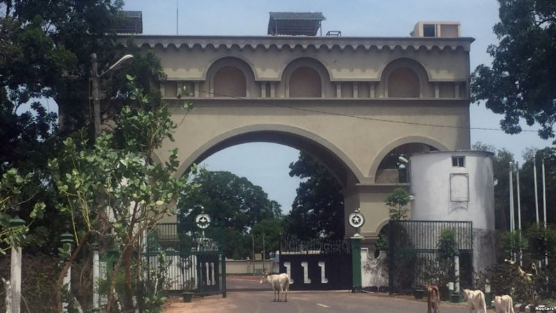 Cattle amble toward an archway at the entrance of former Gambian President Yahya Jammeh's estate in Kanilai, Gambia, July 1, 2017.