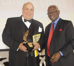 Photo: Africa Economy Builders Babacar Ndiaye (right) presenting the Africa Economy Builders Award to Ambassador Harold E. Doley, Jr. in Abidjan in April.