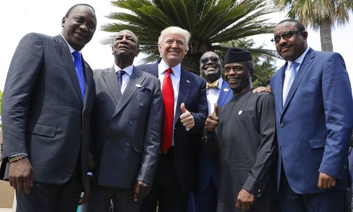 U.S. President Donald Trump poses with African leaders, from left, Kenya's President Uhuru Kenyatta, President of the African Union Alpha Conde', President of the African Development Bank Akinwumi Adesina, Nigeria's Vice President Yemi Osinbajo and Ethiopia's Prime Minister Haile Mariam Desalegn, in the Sicilian town of Taormina, Italy, Saturday, May 27, 2017. (AP Photo/Andrew Medichini)