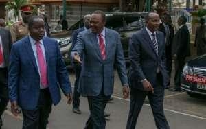 Kenya's President Uhuru Kenyatta (C) walks with Interior Cabinet Secretary Fred Matiangi and legislator Adan Duale before addressing the media outside his office in Nairobi Kenya, August 14, 2017. Presidential Press Service/Handout via REUTERS