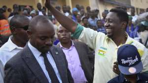 In this photo taken Friday, July 28, 2017, presidential candidate Frank Habineza, center-right, of the opposition Democratic Green Party gestures to supporters at an election campaign rally in Musanze District, Rwanda. Incumbent President Paul Kagame has been in power since the end of the country's genocide in 1994 and is widely expected to win another term in the Aug. 4 elections, after the government earlier this month disqualified all but three candidates. (AP Photo/Eric Murinzi)