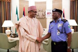Ibrahim Idris Kpotun  the current acting Nigerian Inspector General of Police in a file picture with President Buhari