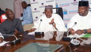 (L-R) Ag. Group Managing Director, Dangote Sugar Refinery Plc, Engr. Abdullahi Sule, Chairman, Dangote Sugar Refinery Plc, Aliko Dangote, Niger State Governor, Abubakar Sani Bello, at the MoU signing ceremony between Dangote Sugar Refinery Plc and Niger State Government on Sugar Project in Niger State at Goverment House, Minna, on Wednesday, August, 23rd , 2017