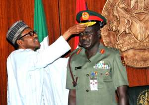 File Picture.President Muhammadu Buhari Decorating The Chief Of Army Staff, Maj.-Gen. Tukur Buratai With His New Rank Cap Of Lt.-Gen, At The Presidential Villa In Abuja On Thursday (13/8/15) | NAN
