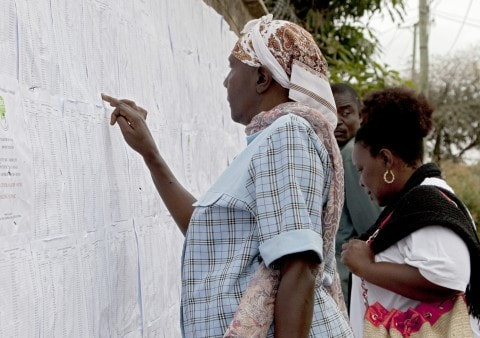 Kenyans check names on the electoral lists at a polling station in the Nairobi South C, in Nairobi, Kenya, Monday Aug. 7, 2017. Kenyans are due to go to the polls on Aug. 8, to vote in presidential elections after a tightly-fought race between President Uhuru Kenyatta and main opposition leader Raila Odinga. ( (Sayyid Abdul Azim/Associated Press)