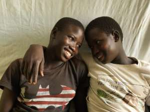 Tabu Sunday (left), the symbolically named one millionth South Sudanese refugee to arrive in Uganda, relaxes with her twin sister Rena in their shelter at the Imvepi settlement. ; UNHCR has named 14-year-old Tabu Sunday as the symbolic one millionth refugee from South Sudan to arrive in Uganda. Tabu made the perilous journey to Imvepi settlement in northern Uganda to escape the fighting in her hometown of Yei. She travelled with her aunt, twin sister Rena and little brother Emmanuel. The children, who are registered as unaccompanied minors, now live with a foster family in the settlement and attend the school that UNHCR built. Imvepi opened in February 2017 and by the end of July it was hosting 140,000 refugees. The challenges facing Tabu include a shortage of food, water and class overcrowding at school. In total, some 4 million South Sudanese have been displaced from their homes by the violent conflict that began in December 2013, making it one of the world's largest refugee situations.