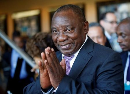 FILE PHOTO: South African Deputy President Cyril Ramaphosa greets security personnel at the World Economic Forum on Africa 2017 meeting in Durban, South Africa, May 5, 2017. Picture taken May 5, 2017. REUTERS/Rogan Ward/File Photo