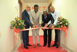 From left: QNET Board Adviser, David Sharma, Deputy Minister for Health, Community Development, Children and Elderly, Hamisi Kigwangalla; Permanent Secretary for Trade, Industry and Investment Adelhelm Meru and QNET Country Representative for Tanzania, Benjamin Mariki cut the ribbon during the opening of QNET Agent office in Tanzania.