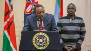 Kenya's President Uhuru Kenyatta flanked by his deputy, William Ruto, addresses the nation at State House in Nairobi, Kenya, Sept. 1, 2017.