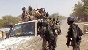 FILE - Cameroon soldiers check a truck on the border between Cameroon and Nigeria as they combat regional Islamic extremists including Boko Haram, Feb. 19, 2015.