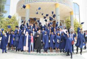 The newly graduated PAUWES Class of 2017 celebrates outside the University of Tlemcen Auditorium