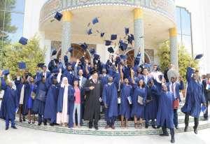 The newly graduated PAUWES Class of 2017 celebrates outside the University of Tlemcen Auditorium