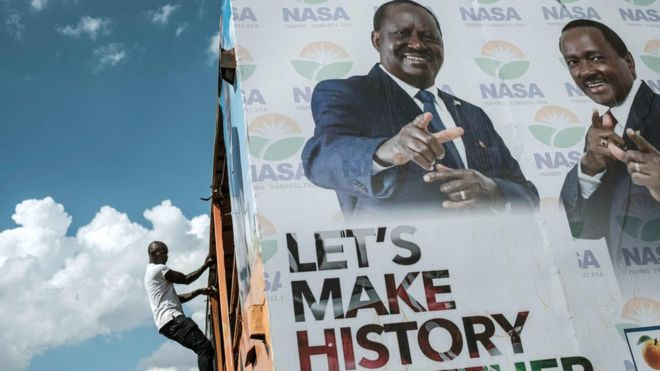 Opposition leader Raila Odinga (left on poster) successfully challenged August's result in court