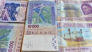FILE - CFA franc banknotes by the Central Bank of West African States are seen in N'djamena, Chad, April 9, 2016.