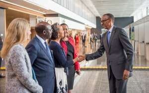 Rwandan President Paul Kagame in a hand shake with Florie Liselle of the CCA