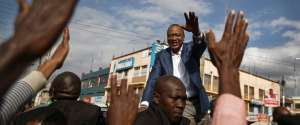 "Kenya's President Uhuru Kenyatta gestures to his supporters after addressing them on a street in Ongata Rongai, on the outskirts of Nairobi, Kenya, Tuesday, Sept. 5, 2017. Kenya faces an Oct. 17 vote after the Supreme Court nullified Kenyatta's re-election but opposition leader Raila Odinga said Tuesday he does not accept the date, demanding reforms to the electoral commission and other ""legal and constitutional guarantees."" (AP Photo/Ben Curtis)"