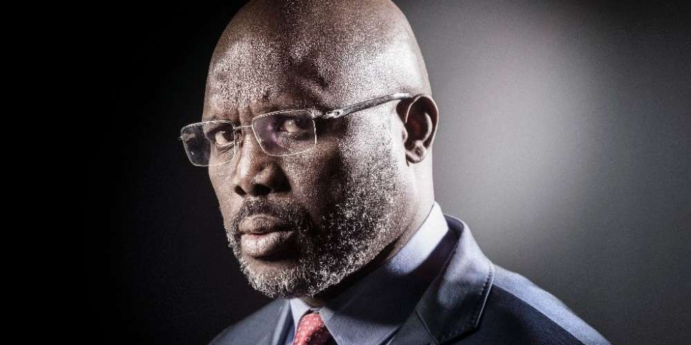 Liberian football hero George Weah is a frontrunner in next Tuesday's presidential elections (AFP Photo/JOEL SAGET)