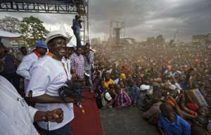 """Kenyan opposition leader Raila Odinga, left, dances after arriving at a rally attended by thousands of supporters in the Shauri Moyo area of Nairobi, Kenya Wednesday, Oct. 18, 2017. The head of the election commission said Wednesday that it is """"difficult to guarantee a free, fair and credible election"""" in Kenya's fresh presidential vote only eight days away, just hours after a top Kenyan electoral official resigned saying the election on Oct. 26 cannot be credible as planned. (AP Photo/Ben Curtis)"""