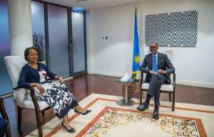 CCA's Florie Liser with Rwandan President Paul Kagame