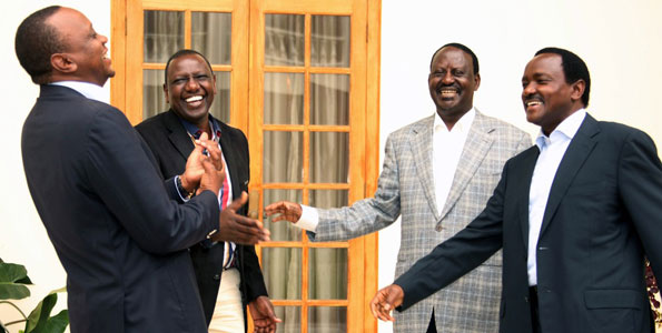 Perfect rematch .In this 2013 file picture President Uhuru Kenyatta his Deputy William Ruto share a light moment with Former Prime Minister Raila Odinga and his running mate Mr Kalonzo Musyoka at State House Nairobi. PHOTO/FILE NATION MEDIA GROUP