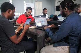 Technology entrepreneurs work from their computers and mobile phone, at Activspaces co-working tech hub in Douala, Cameroon Thursday, Feb. 9, 2017. Internet users in English-speaking regions lost connectivity from all three telecom internet companies, after the Cameroon government warned against anti-state comments and fake news on social media. Technology start-ups are suffering from the ban, and some travel to French-speaking cities to keep their businesses operating.Pic credit Irene Zih Fon, GPJ Cameroon
