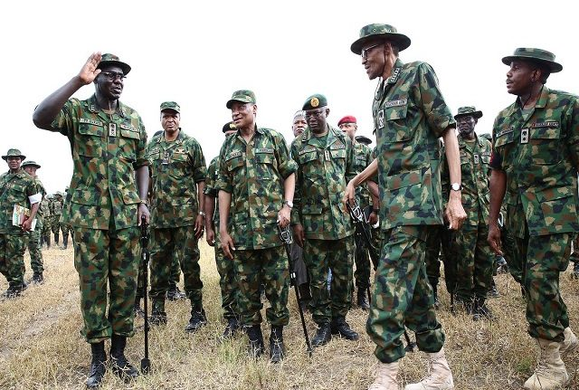 File picture:President Buhari interacts with troops of HQ 1 BDE in Dansadau Zamfara State as part of the 2016 Nigerian Army Day celebration on 13th July 2016
