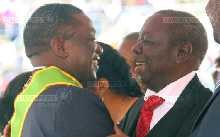 President Emmerson Mnangagwa being congratulated by MDC T president Morgan Tsvangirai after his inauguration at the National Stadium in Harare