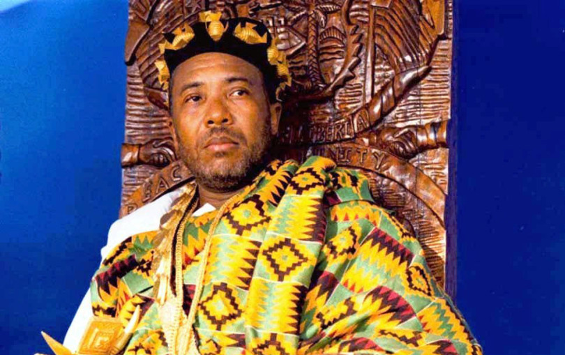 "FILE - In this undated file photo, Liberian President Charles Taylor sits on a throne during a ceremony in Monrovia where Ghanian immigrants crowned him Chief Okatakyie, ""The Greatest of Warriors"". Taylor served as Liberia's president between 1997 and 2003, and was accused of greed and savagery during his leadership. (AP Photo/David Guttenfelder, File)"