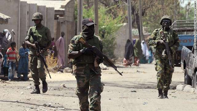 Nigerian soldiers on guard in one of Borno villages.