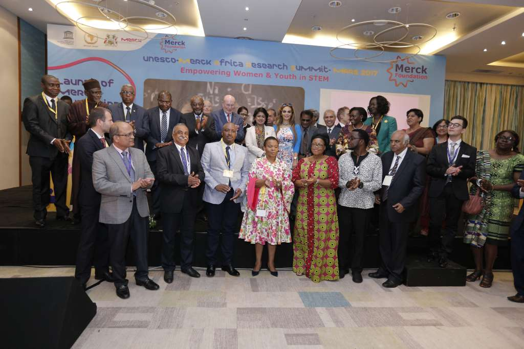 Prof. Frank Stangenberg-Haverkamp, Chairman of the Executive Board of E. Merck KG, President of the Republic of Mauritius, Her Excellency Mrs Ameenah Grurib-Fakim (centre), and Dr. Rasha Kelej, CEO of Merck Foundation pose for a group photo with ministers and dignitaries at the inauguration of the UNESCO Merck Africa Research Summit on November 28, 2017