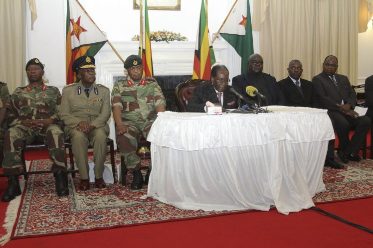 Zimbabwean President Robert Mugabe delivers his speech during a live broadcast at State House in Harare, Sunday, Nov, 19, 2017. Zimbabwe's President Robert Mugabe baffled the country by ending his address on national television without announcing his resignation. (AP Photo/Tsvangirayi Mukwazhi)