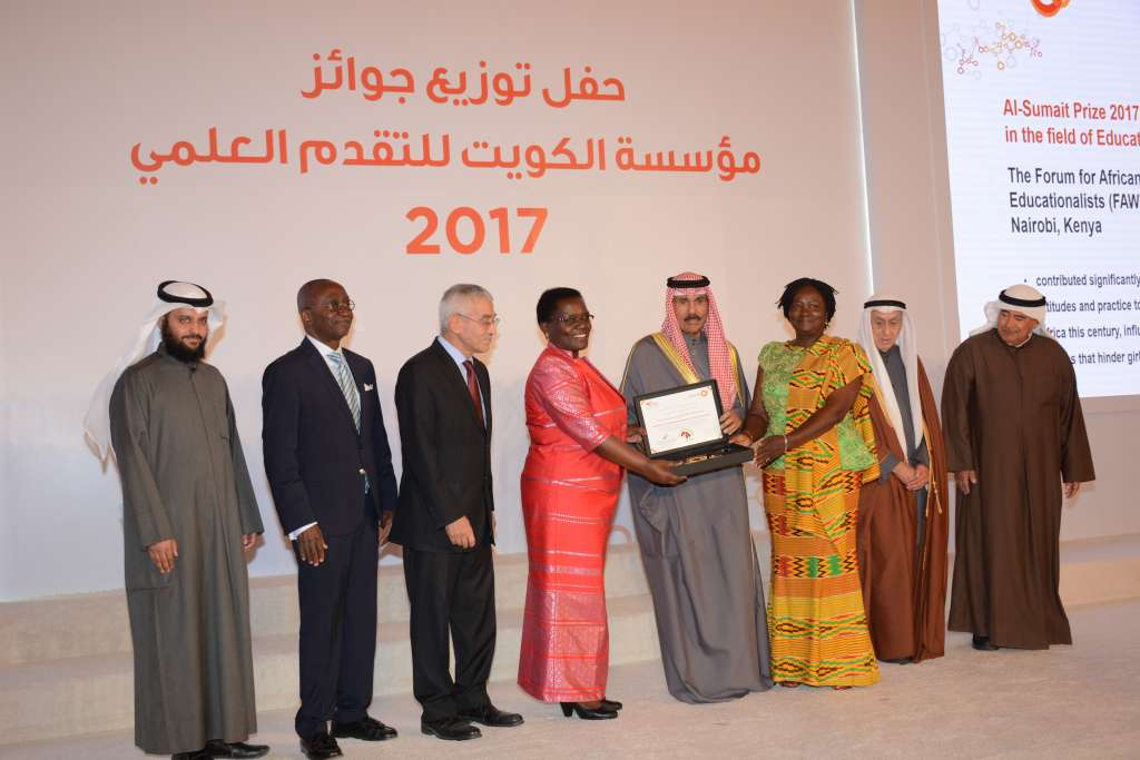 His Highness Deputy Amir Crown Prince Nawaf Al Ahmed Al Sabah hands over Al-Sumait Prize to Executive Director of FAWE Africa Hendrina Doroba