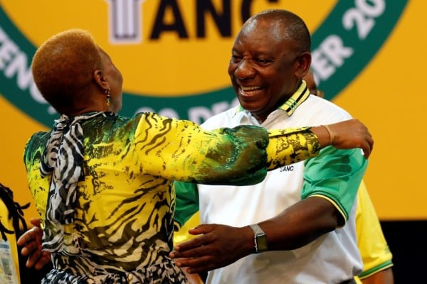 Cyril Ramaphosa greets a party member during the 54th national conference of the African National Congress in Johannesburg on Dec. 18. (Siphiwe Sibeko/Reuters)