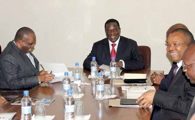President Emmerson Mnangagwa speaks to the visiting AFREXIMBANK president and chairman of the board of directors Dr Okey Oramah(left) while  Finance and Economic Development minister Patrick Chinamasa and Reserve Bank Governor John Mangudya  looks on at Munhumutapa Offices in Harare yesterday.-(Picture by Innocent Makawa)