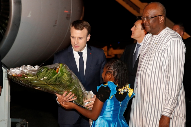 French President Emmanuel Macron is welcomed by Burkina Faso's President Roch Marc Christian Kabore at Ouagadougou airport, Burkina Faso November 27, 2017. REUTERS/Philippe Wojazer