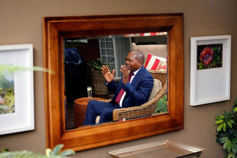 "Dr Zweli Mkhize, one of the ANC's ""top six"" leaders, is reflected in a mirror as he speaks to Reuters in Johannesburg, South Africa, December 6, 2017. REUTERS/Siphiwe Sibeko Reuters"