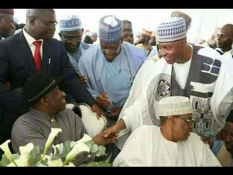 Saraki(standing in handshake with former President Goodluck Jonathan