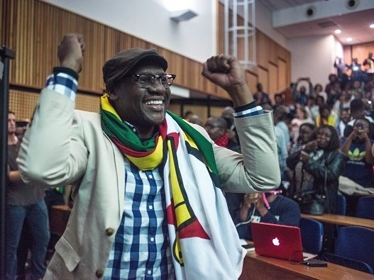 """Zimbabwean Pastor Evan Mawarire, acquitted recently of trying to subvert the government, has deftly used social media in a quest for justice and rights. """"It's important that we let the administration that is coming in right now know that if they do to us what Robert Mugabe's government did to us, we will do the same thing to them that we've done to Robert Mugabe,"""" he recently told journalists. Mujahid Safodien/AFP/Getty Images"""