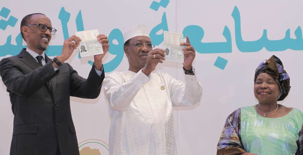 Rwanda's Paul Kagame and Chad's Idriss Derby displaying their copies of the African Union Passport