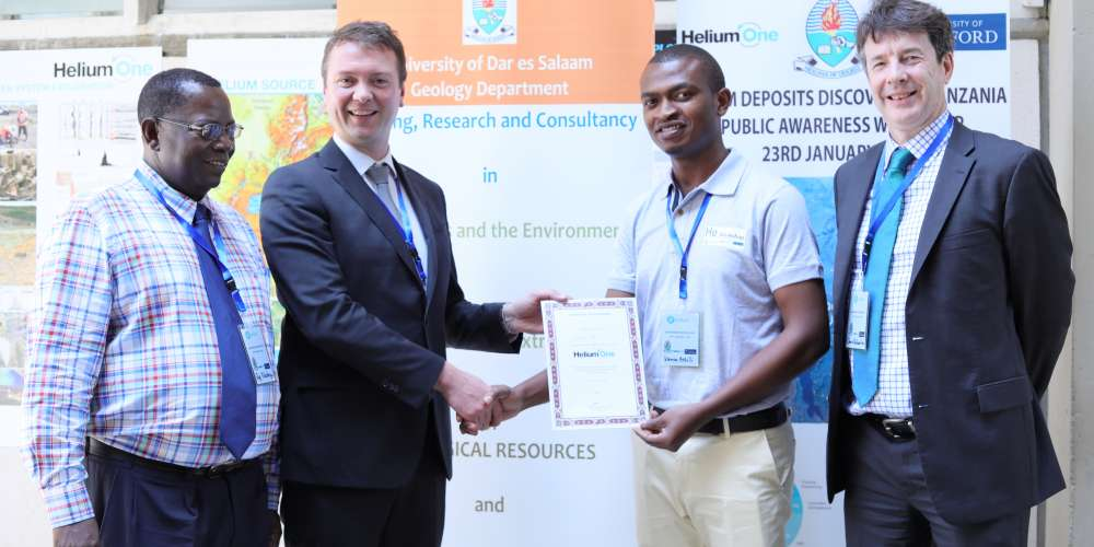 Helium One's Chief Executive Officer, Thomas Abraham-James hands a sponsorship certificate for a funded MSc programme at Oxford University to Karim Mtili, a graduate of BSc with Geology from University of Dar es Salaam. The sponsorship is geared towards imparting world-class technical skills and scientific expertise to Tanzanians. Witnessing this is Prof Christopher Ballentine from Oxford University and Prof Hudson Kotago from University of Dar es Salaam