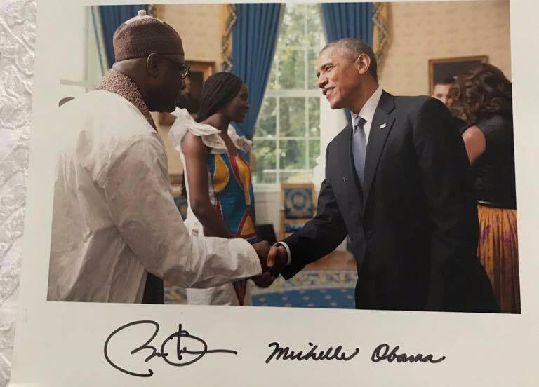 Former President Barack Obama in a handshake with Omar Faye