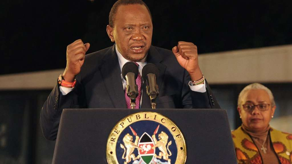 Kenya's President Uhuru Kenyatta speaks after the electoral commission's official announcement of the August election results, which were annulled by the Supreme Court. (John Muchucha / AFP / Getty Images)
