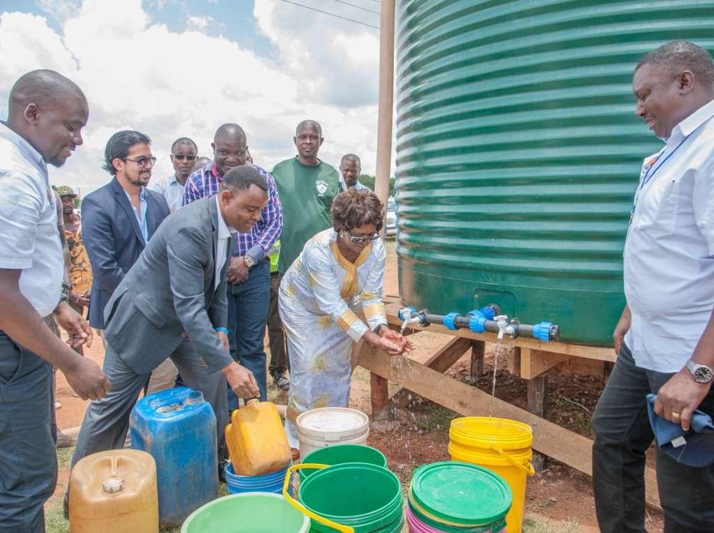 2Hon. Margaret Mwanakatwe, Zambian Breweries country director Jose Moran and corporate affairs director Ezekiel Sekele test the water in Bauleni.