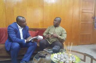 Hon Adjei Sowah with PAV's Ajong Mbapndah L at his AMA Office in Accara,Ghana